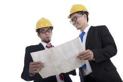 Architects checking the blueprint Stock Photo