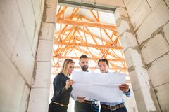 Architects and civil engineer at the construction site. Royalty Free Stock Photos