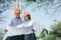 Architects with construction plan Royalty Free Stock Image