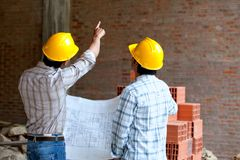 Architects at a construction site Royalty Free Stock Photos