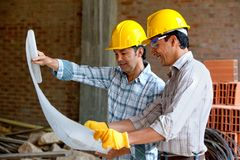 Architects at a construction site Royalty Free Stock Images