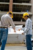 Architects at a construction site Stock Images