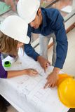 Architects at a construction site Stock Photos