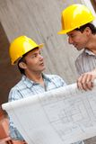 Architects at a construction site Royalty Free Stock Photo