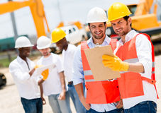 Architects at a construction site Royalty Free Stock Image