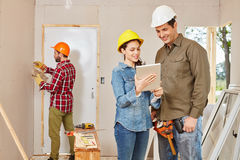 Architects and craftsmen renovating in teamwork Royalty Free Stock Image