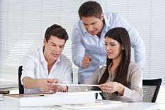 Architects creating a house model Stock Photography