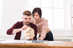 Architects creating house model in office Royalty Free Stock Photo
