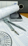 An architects desk with plans Stock Photo