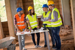 Architects discussing about blue print Royalty Free Stock Photos