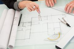 Architects discussing blueprints Royalty Free Stock Photography