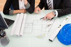 Architects discussing blueprints Stock Images