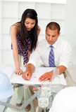 Architects discussing a construction plan Stock Photos