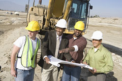 Architects Discussing At Construction Site Stock Images