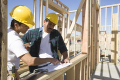Architects Discussing At A Construction Site Royalty Free Stock Image