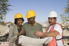 Architects Discussing At Construction Site Royalty Free Stock Photography