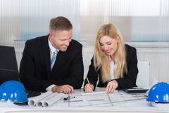 Architects Discussing Over Blueprint In Office Royalty Free Stock Photo