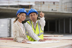 Architects Discussing Plans At Site Royalty Free Stock Photography