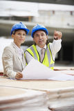 Architects Discussing Plans At Site Stock Photography