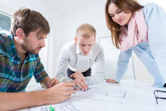 Architects draws a design in the office Royalty Free Stock Photography
