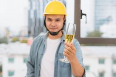 Architects drinking champagne in the office royalty free stock image