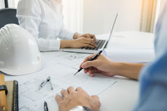 Architects engineer discussing at the table with blueprint - Clo Royalty Free Stock Photography