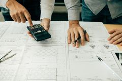Architects or engineering working with blueprints and discussing project together at the meeting in the office stock photos