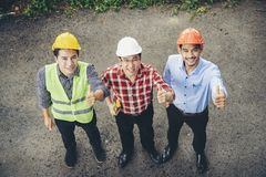Architects and engineers are collaborating to work together as a royalty free stock photos