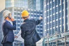 Architects, engineers and consultants in meeting their assigned. Tasks.Pointing his hand to the goal of success stock photography