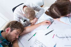 Architects fell asleep while working Royalty Free Stock Image