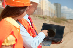 Architects  in front of building site Royalty Free Stock Images