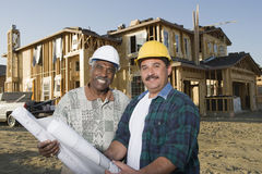 Architects In Front Of Incomplete House Royalty Free Stock Image
