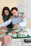 Architects gathered around model Stock Photo
