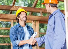 Architects Greeting Each Other At Construction Royalty Free Stock Photo