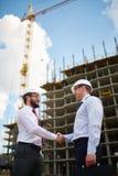 Architects handshaking Stock Photography