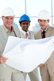 Architects with hardhat looking at blueprints Royalty Free Stock Image