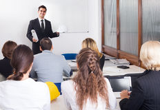 Architects having advanced training courses in classroom. Adult architects having advanced training courses in classroom Royalty Free Stock Image