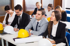 Architects having advanced training courses in classroom. Professional american architects having advanced training courses in classroom stock photos