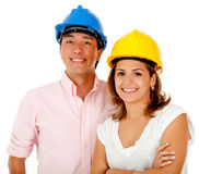 Architects with helmets Stock Photos