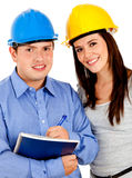 Architects with helmets Royalty Free Stock Photo