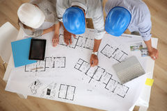 Architects with helmets working together Stock Photo