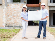 Architects holding a banner Royalty Free Stock Photo