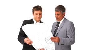 Architects holding a building plan Royalty Free Stock Images