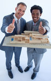 Architects holding a model house Royalty Free Stock Images