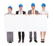 Architects holding placard Royalty Free Stock Photos
