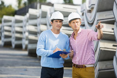 Architects inspecting stock at site Stock Images