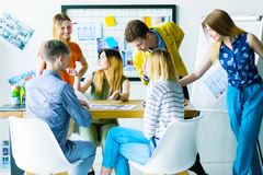 Designers and architects working at office. Architects interior designers creative people manager office workers discussing concept idea new apartment design royalty free stock images