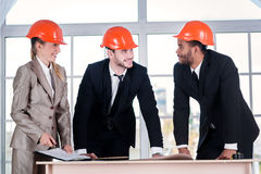Architects laid hands on hands. Three businessmеn architect met royalty free stock photo