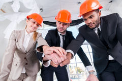 Architects laid hands on hands. Three businessmеn architect met Royalty Free Stock Photography