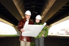 Architects looking at blueprint. Royalty Free Stock Photo